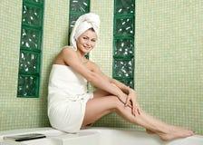 Beautiful woman in a bathroom Stock Photos