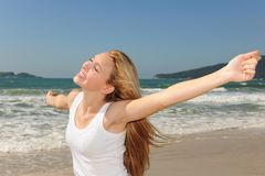 Beautiful woman on the beach. With arms raised royalty free stock photo