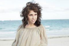 Beautiful woman on the beach Stock Photos