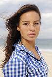Beautiful woman by the beach Royalty Free Stock Image