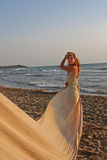 Beautiful woman at the beach Stock Photography