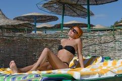 Beautiful woman on a beach Stock Photo