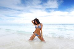 Beautiful woman on beach Royalty Free Stock Image