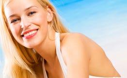 Beautiful woman on beach Stock Image