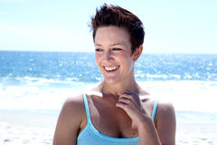 Beautiful Woman at the Beach. Looking away with a toothy smile Royalty Free Stock Photo