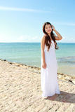 Beautiful woman at the beach alone and smiling Stock Images