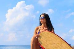 Beautiful woman on the beach. Stock Photos
