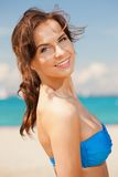 Beautiful woman on a beach Stock Photo