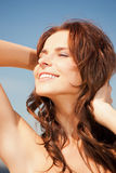 Beautiful woman on a beach. Bright picture of beautiful woman on a beach Royalty Free Stock Image