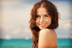 Beautiful woman on a beach Stock Images
