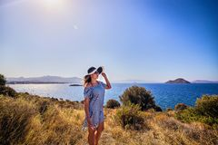 Beautiful woman in beach hat enjoying sea view with blue sky at sunny day in Bodrum, Turkey. Vacation Outdoors Seascape Summer. Beautiful woman in beach hat stock images