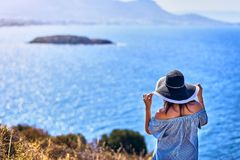 Beautiful woman in beach hat enjoying sea view with blue sky at sunny day in Bodrum, Turkey. Vacation Outdoors Seascape Summer stock photography