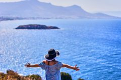 Beautiful woman in beach hat enjoying sea view with blue sky at sunny day in Bodrum, Turkey. Vacation Outdoors Seascape Summer. Travel Concept stock photography