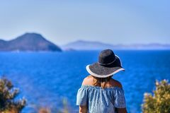 Beautiful woman in beach hat enjoying sea view with blue sky at sunny day in Bodrum, Turkey. Vacation Outdoors Seascape Summer royalty free stock photography