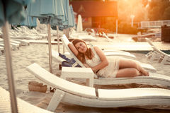 Beautiful woman on beach at hotel at evening Royalty Free Stock Photo
