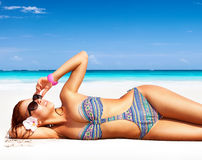 Beautiful woman on the beach royalty free stock photo