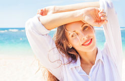 Beautiful woman on the beach. Portrait of pretty young woman posing on the beach Royalty Free Stock Photos