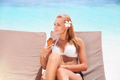 Beautiful woman on the beach Stock Photography