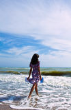 Beautiful woman on the beach reading letter Royalty Free Stock Image