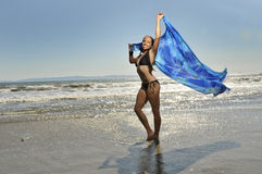 Beautiful woman on beach with scarf n breeze. Wonan on beach with sarong blowing n breeze Royalty Free Stock Photos