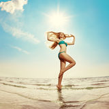 Beautiful woman on the beach by the sea Royalty Free Stock Images