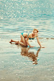 Beautiful woman on the beach by the sea Stock Photo
