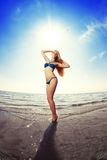 Beautiful woman on the beach by the sea Stock Photography