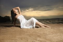 A beautiful woman on the beach sunset Stock Photos
