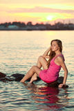 Beautiful woman on the beach at sunset. Enjoy nature. Luxury gir Royalty Free Stock Photography