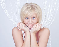 Beautiful woman with bead curtains Royalty Free Stock Images