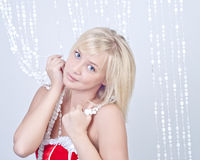 Beautiful woman with bead curtains Stock Photo