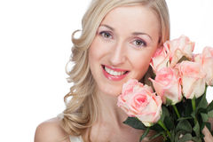 Beautiful woman with beautiful roses Royalty Free Stock Image