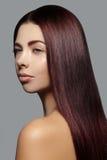 Beautiful woman with beautiful straight shiny hair, fashion makeup. Glamour make-up. Beautiful smooth hairstyle Stock Image