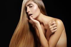 Beautiful woman with beautiful straight shiny hair, fashion makeup. Glamour make-up. Beautiful smooth hairstyle Royalty Free Stock Photo