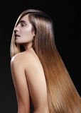 Beautiful woman with beautiful straight shiny hair, fashion makeup. Glamour make-up. Beautiful smooth hairstyle Stock Images