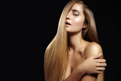 Beautiful woman with beautiful straight shiny hair, fashion makeup. Glamour make-up. Beautiful smooth hairstyle Royalty Free Stock Photography