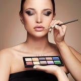 Beautiful woman. beauty girl with make-up.Makeup artist applies lipstick Royalty Free Stock Photo