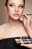 Beautiful woman. beauty girl with make-up.Makeup artist applies lipstick Royalty Free Stock Photos