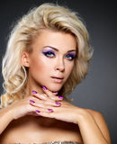 Beautiful woman with beauty manicure and makeup Royalty Free Stock Photo