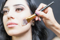 Beautiful woman at beauty salon receives makeup Royalty Free Stock Photos