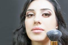 Beautiful woman at beauty salon receives makeup Royalty Free Stock Photos