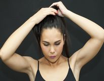 Beautiful  Woman  by becoming a ponytail in her hair Royalty Free Stock Photos