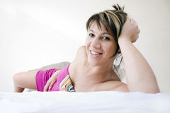 Beautiful woman on bed Stock Photography