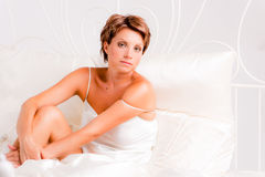 Beautiful woman in bed Stock Image