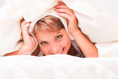 Beautiful woman in bed Royalty Free Stock Photos