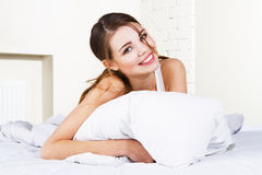 Beautiful woman in bed Stock Photo
