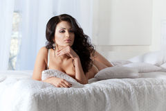 Beautiful woman  on the bed Stock Images