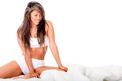 Beautiful woman in bed Stock Photos