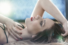 Beautiful woman on the bed. Picture of a beautiful woman lying on the bed stock image