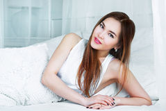 Beautiful  woman in bed. Beautiful young asian woman in bed in the interior Royalty Free Stock Images